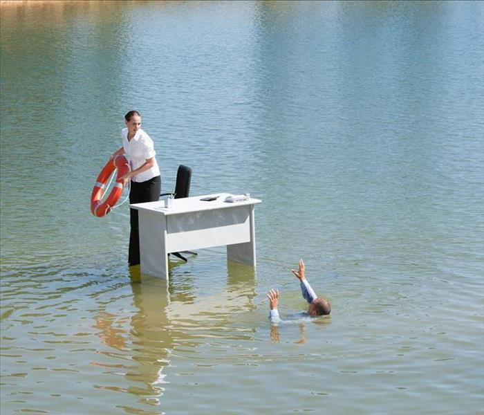 Desk in the middle of water with A Life Tube Being Thrown