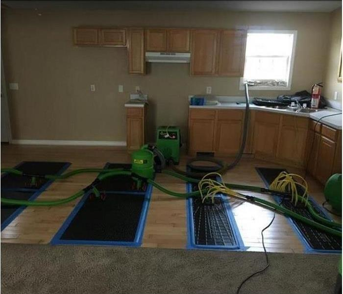 SERVPRO equipment drying water damaged kitchen and floors
